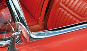 detail of a bright red american vintage car.